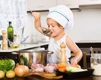 girl-cooking-soup-ladle-home-47328087